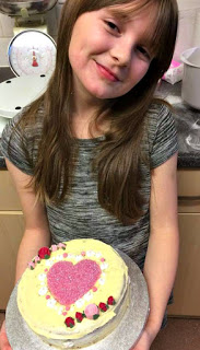 Boo holding her Valentines Cake
