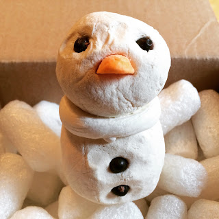 Lush Snowman bath bomb sitting in a box