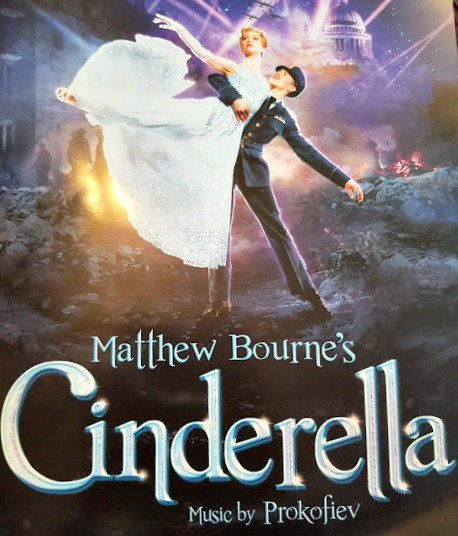 matthew bourne's cinderella program, showing Cinderella being lifted up high by her RAF prince