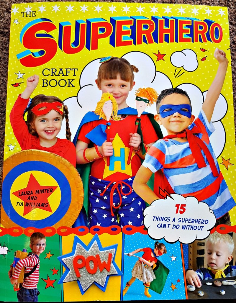 glossy cover of superhero craft book featuring children dressed up as superheros