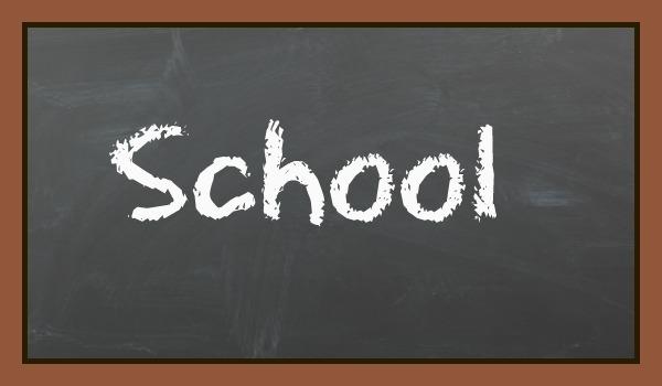 black board with the word school written in chalk