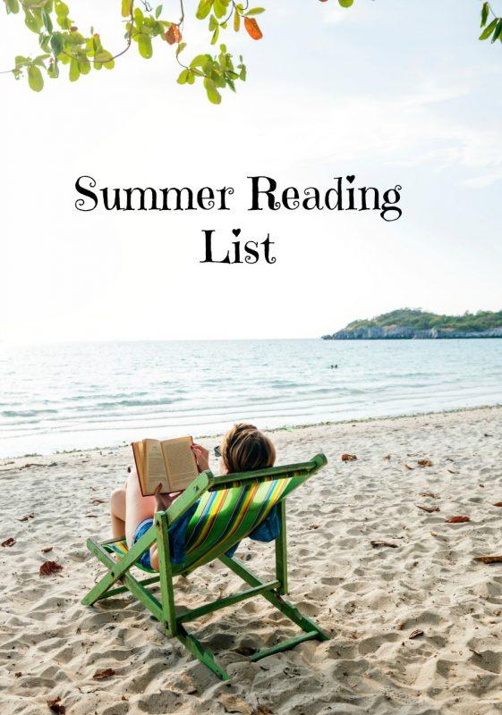 a woman sitting in a deckchair on a beach, reading a book