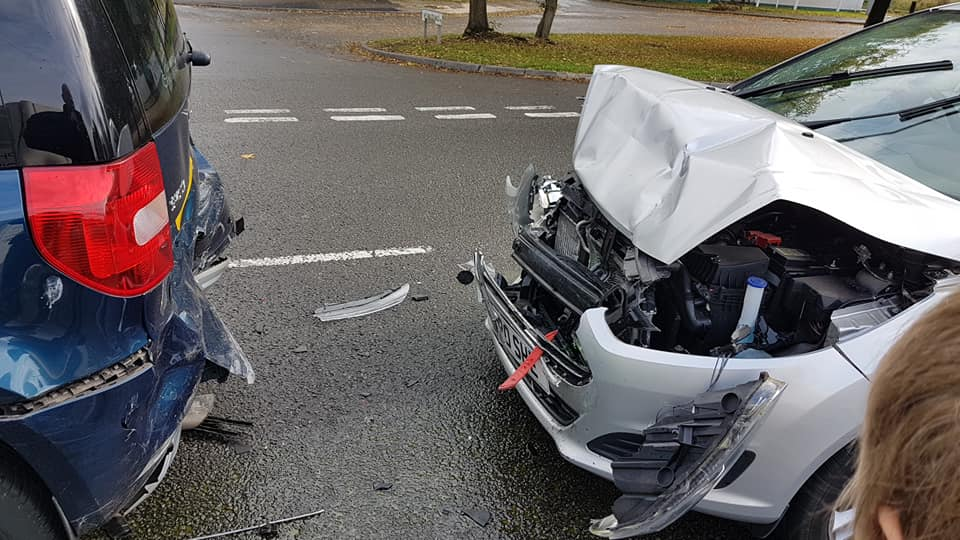 Two cars that have been involved in a collision.